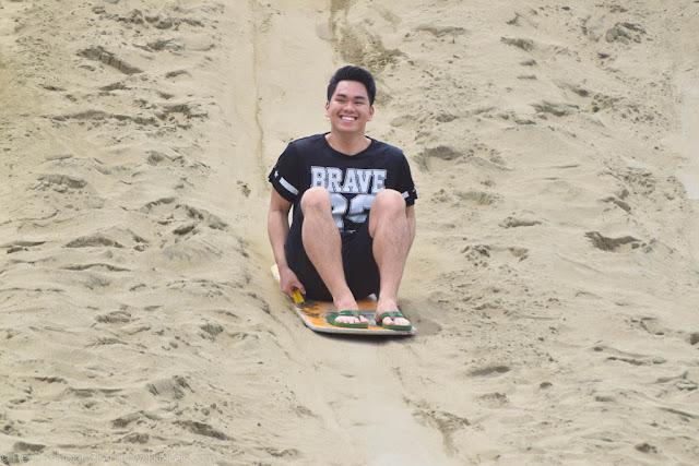 All smiles sliding down the La Paz Sand Dunes