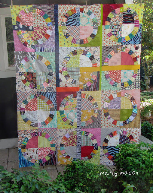 Maximum use of scraps - circle quilt top by Marty Mason
