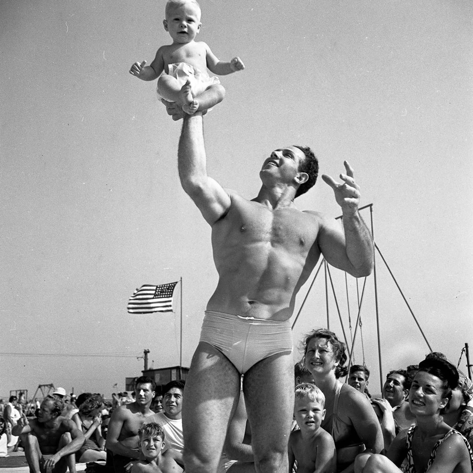 An acrobat and his son.