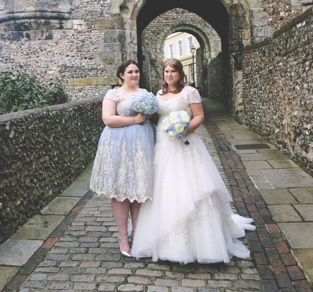 Bride and bridesmaid wedding photo