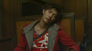 Takaharu slumbers on a Shadow Line train