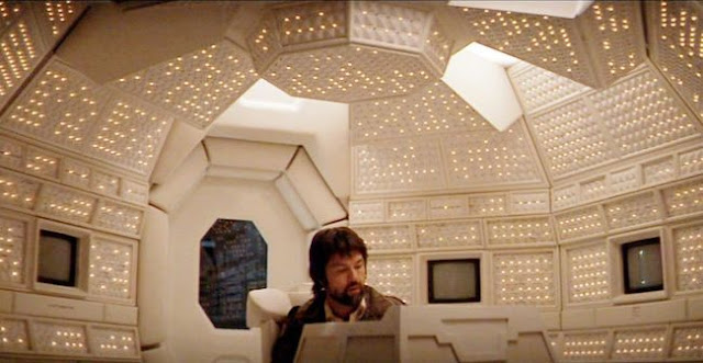 Dallas (Tom Skerritt) sitting at the ships computer, Mother, in Alien