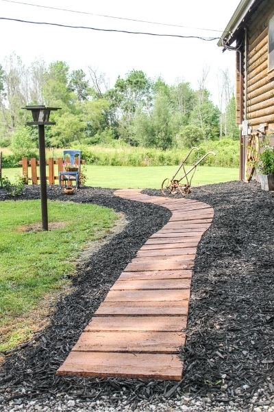 A stained wood rustic pathway made from rough cut lumber!   On The Creek Blog