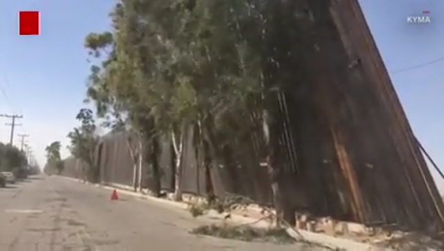 TRUMP'S CRAPPY BORDER FENCE BLOWS OVER IN LIGHT BREEZE