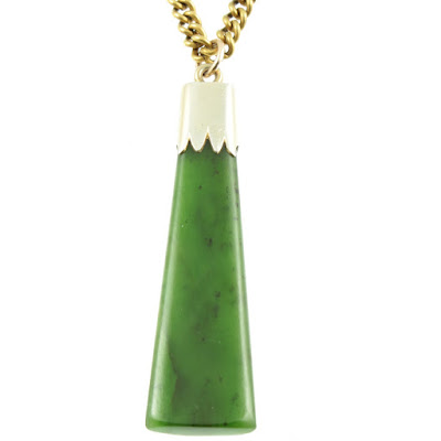 An Art Deco style necklace with an asymmetrical large Jade stone as the pendant