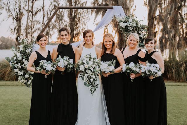 bride and bridesmaids in black