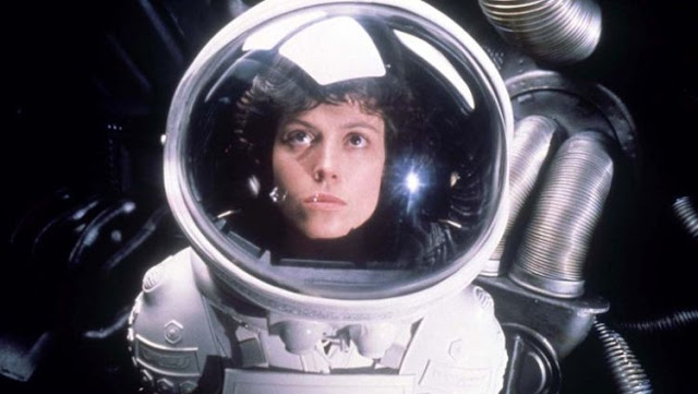 Sigourney Weaver as Ripley wearing a space suit in Alien