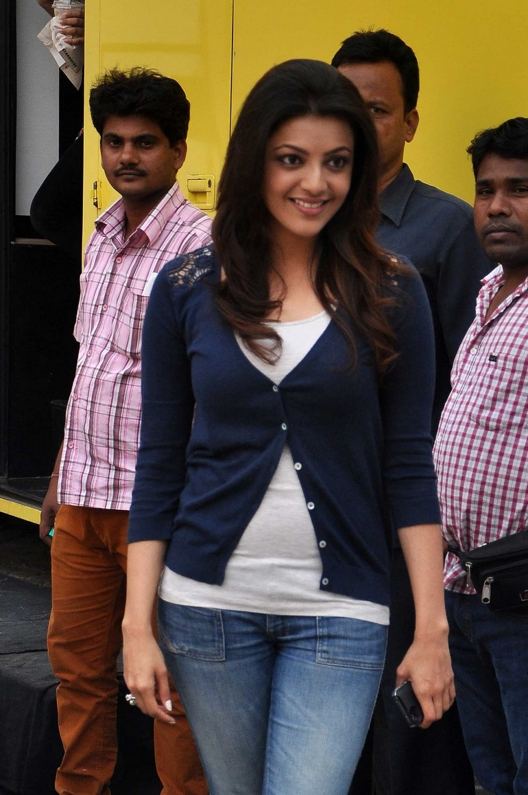 Bollywood Actress Kajal Agarwal Spicy Face Photos In White Top Blue Jeans