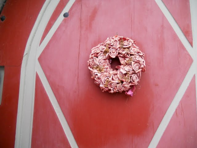 Pink door wreath in Tallinn, Estonia