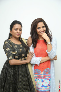 Actress Suma in Black Salwar Suit and Anusuya in orange Dress at winner movie press meet part 1 February 2017 (35).JPG
