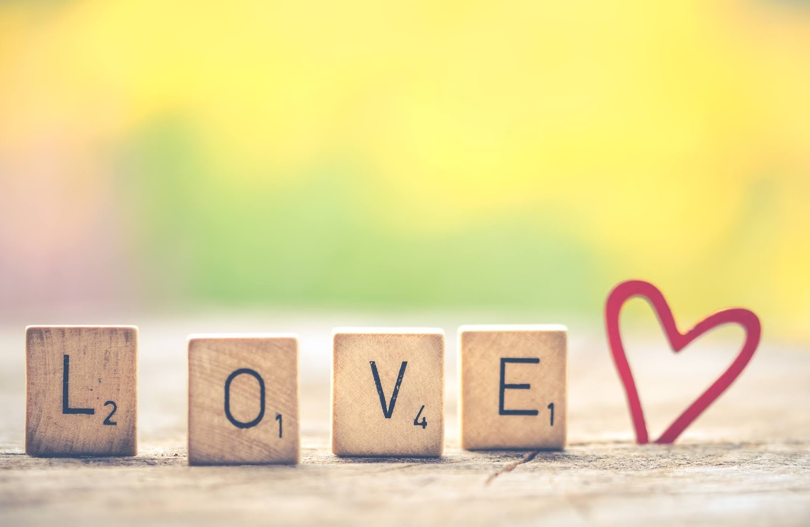 Photo of Scrabble Letter Tiles Forming the Word Love., love images