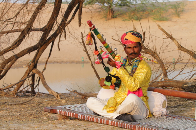 Listening to the Rawan Hatha next to a oasis in the desert off Bikaner, Rajasthan