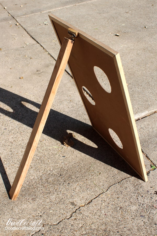 Easel on chalkboard for a bean bag toss game