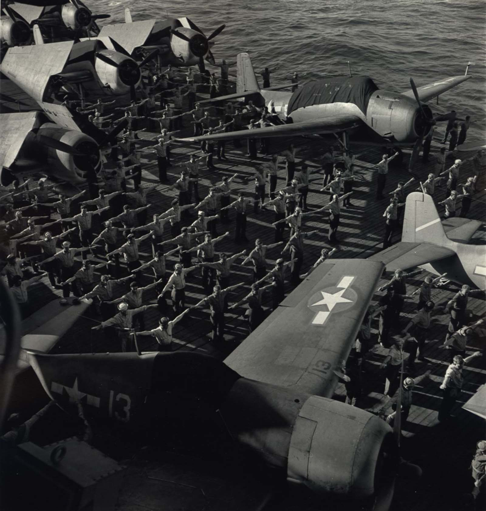 Military Aircraft Aboard U.S.S. Yorktown with Sailors Performing Exercises, 1943.