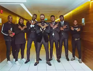 Kiss Daniel and Gang in suit