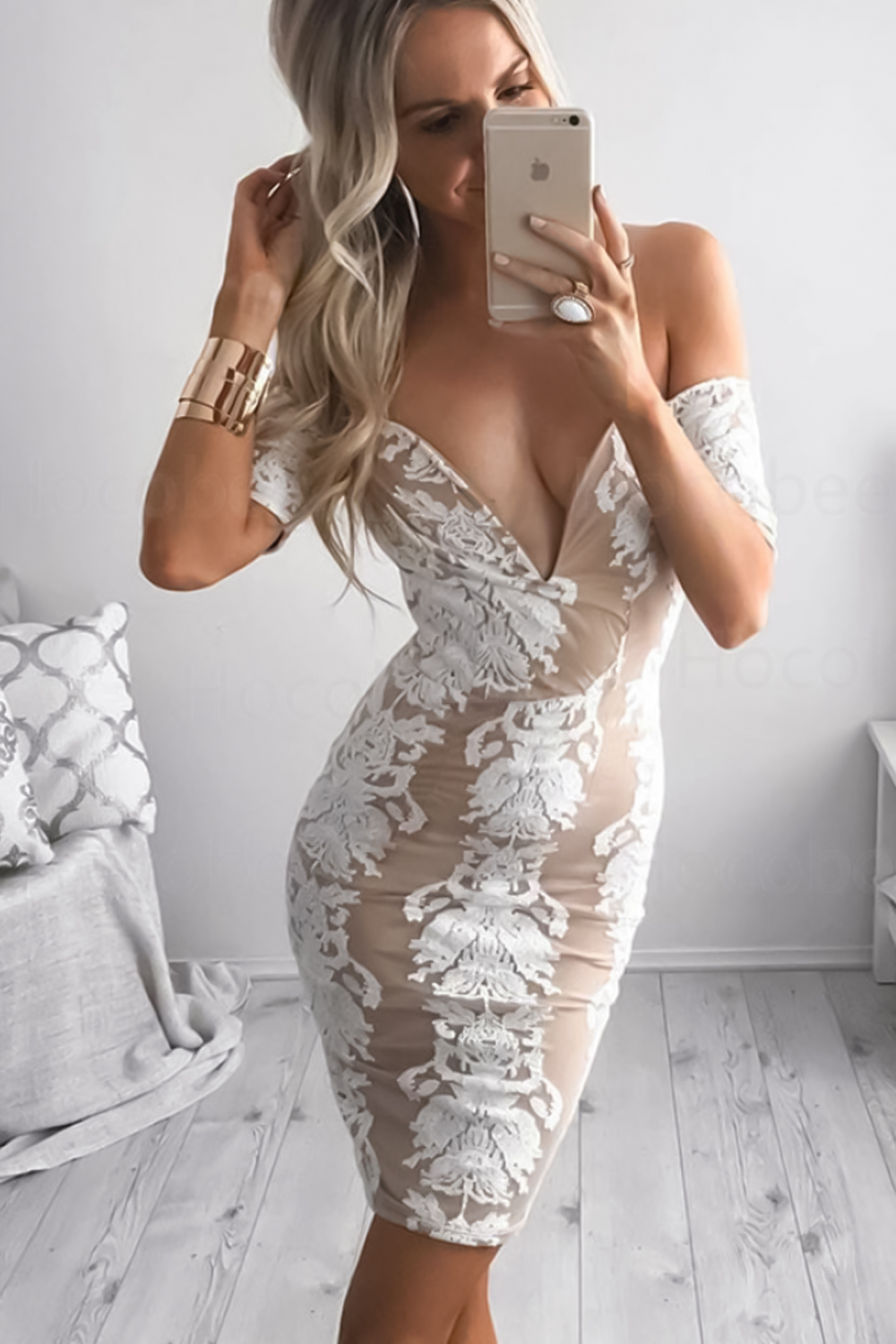 woman in a tight lace dress is taking a selfie