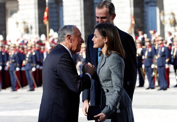Queen Letizia wore Felipe Varela skirtsuit, and Magrit Pumps and carried Magrit clutch bag. Queen Letizia will hold a gala dinner at Royal Palace