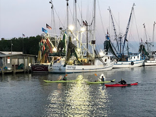 sunset; fishing trawlers; kayaks; Mt. Pleasant; South Carolina; Giorgio Coniglio