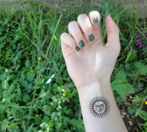 bayan bilek güneş dövmesi woman wrist sun tattoo