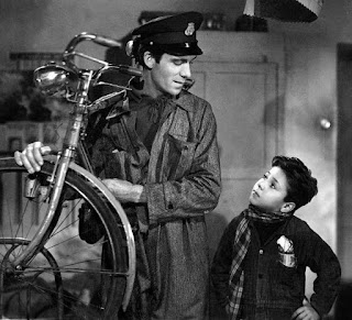 Maggiorani with Enzo Staiola, who played his son, Bruno, in Vittorio de Sica's Bicycle Thieves