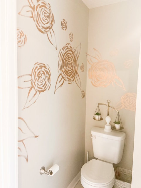 flowers painted with finger in bathroom
