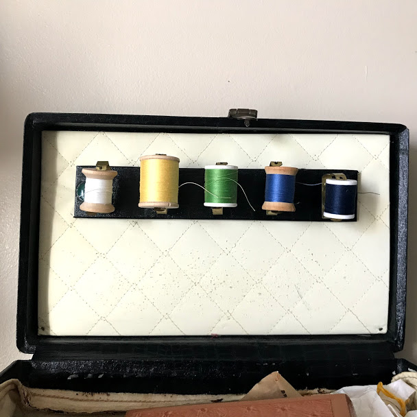 inside of a vintage sewing box