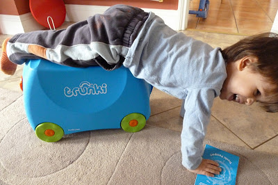 Child playing with new Trunki