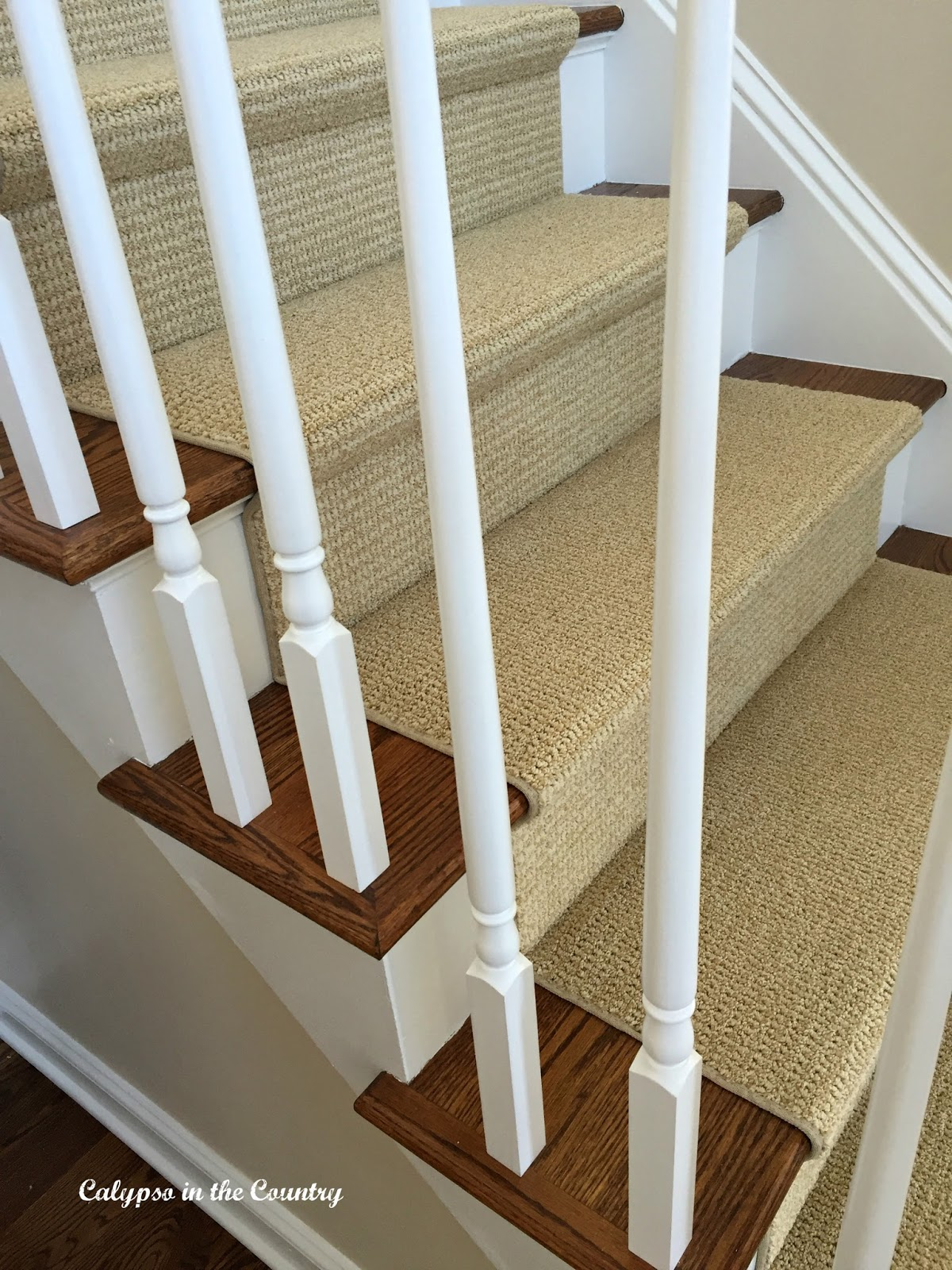 White Stair Spindles and sisal look runner - a whole new look for our foyer.