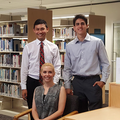 Photo with reporter Ashlee DeMarino and dual grad students Erick Rivera and Richard Audrain