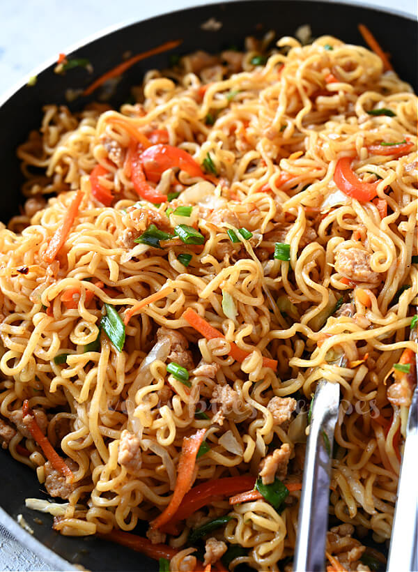 a pan with best egg roll noodle bowl with vegetables and chicken