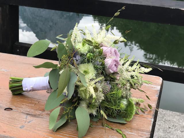 Wild flowers bridal bouquet romantic lilac green white, Wedding abroad, Mountain wedding lake-side at the Riessersee Hotel Resort Bavaria, Germany, Garmisch-Partenkirchen