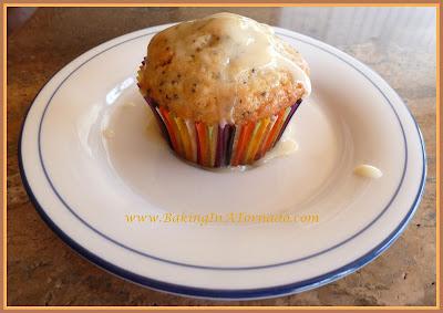 Maple Glazed Mandarin Poppy Muffins | recipe developed by www.BakingInATornado.com | #recipe #breakfast