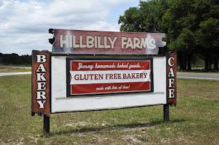 Roadside sign for Hillbilly Farms gluten free bakery near Dade City, FL.