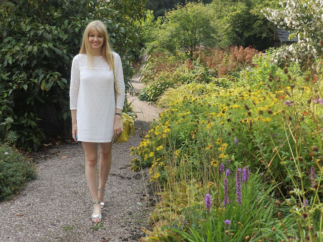 What Lizzy Lovs wears cream lace tunic dress at Ness Botanic Gardens