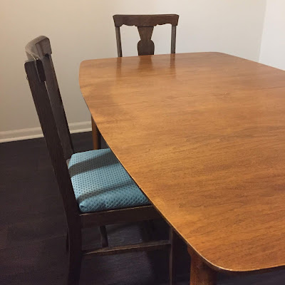 picture of a wooden table with two wooden chairs, bought off facebook marketplace