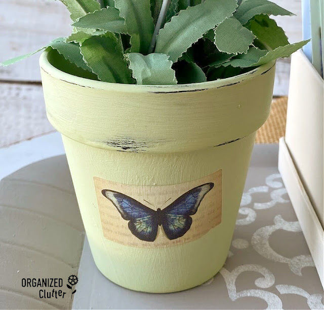 Photo of painted & distressed pot with rub on transfer butterfly