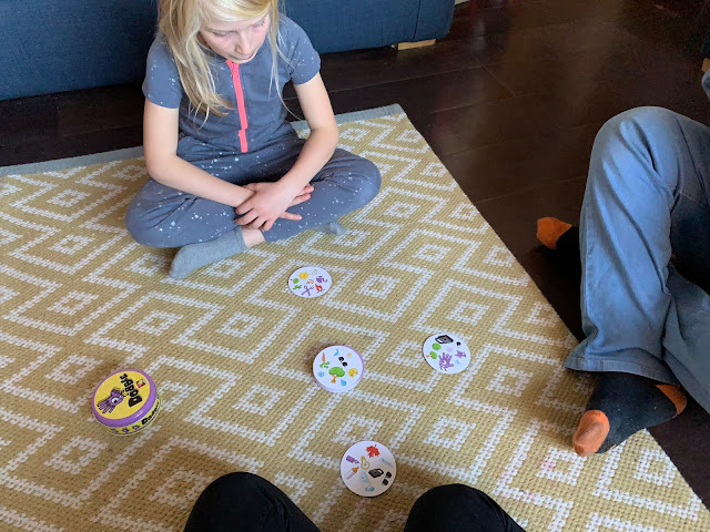 Playing the Tower version of Dobble Family Card Game as part of a review
