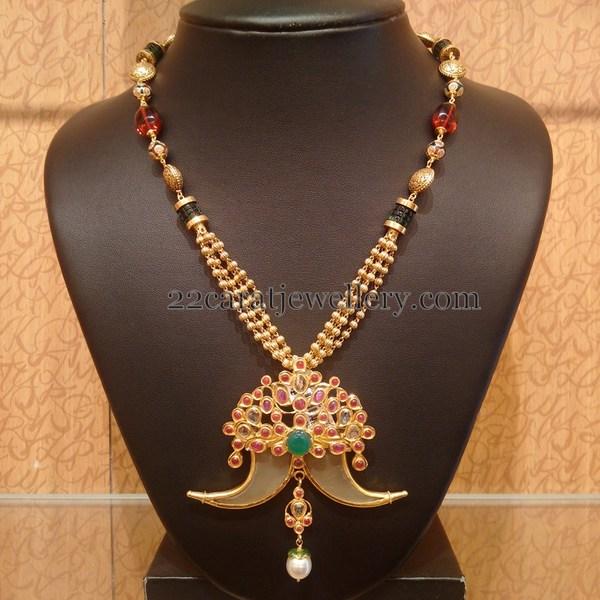 Gold Swirls Set With Tiger Nail Locket Jewellery Designs