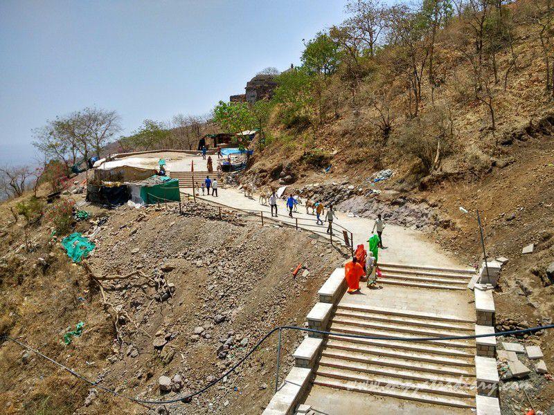 Pilgrims climbing steps at Mahakalika Temple, Pavagad, Champaner Gujarat