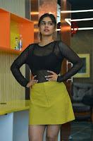 Telugu Actress Sanjana Anand Photos in Black Net Top and Yellow Mini Skirt Dress HeyAndhra.com