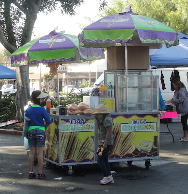colorful churro stand at a flea market