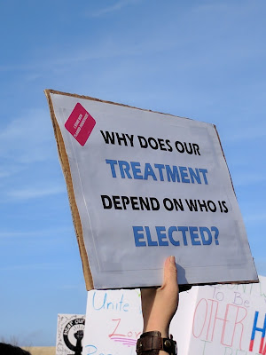 Sign from the Women's March, yesterday: Why does our treatment depend on who is elected?