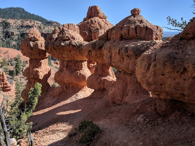 Cool Rock Figurines and Arch in Arches Hike in Bryce Canyon off Losee Road by Panquich, Utah