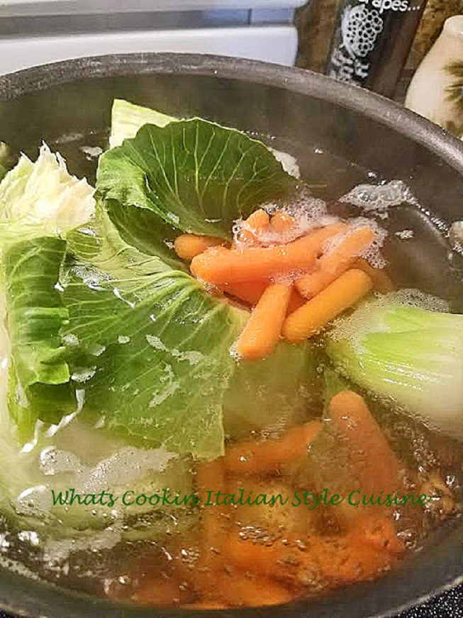 this is a pot of cabbage potatoes and carrots as a side dish for the corned beef dinner