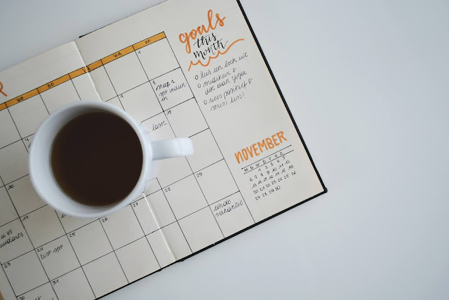 Goal planner style diary with a cup of tea to the side of it