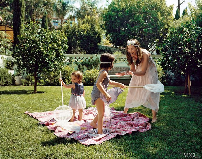 Amanda Peet and children outside on grass in Vogue