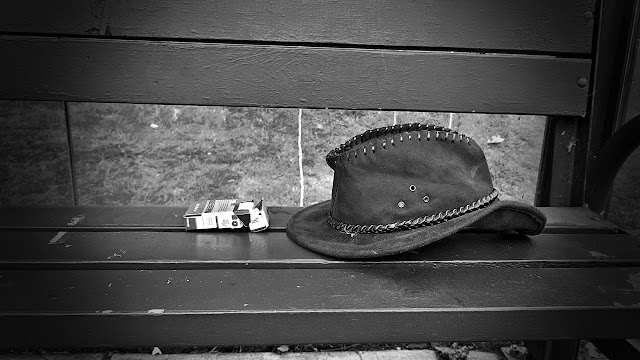 Cigarettes and a well worn hat left behind...