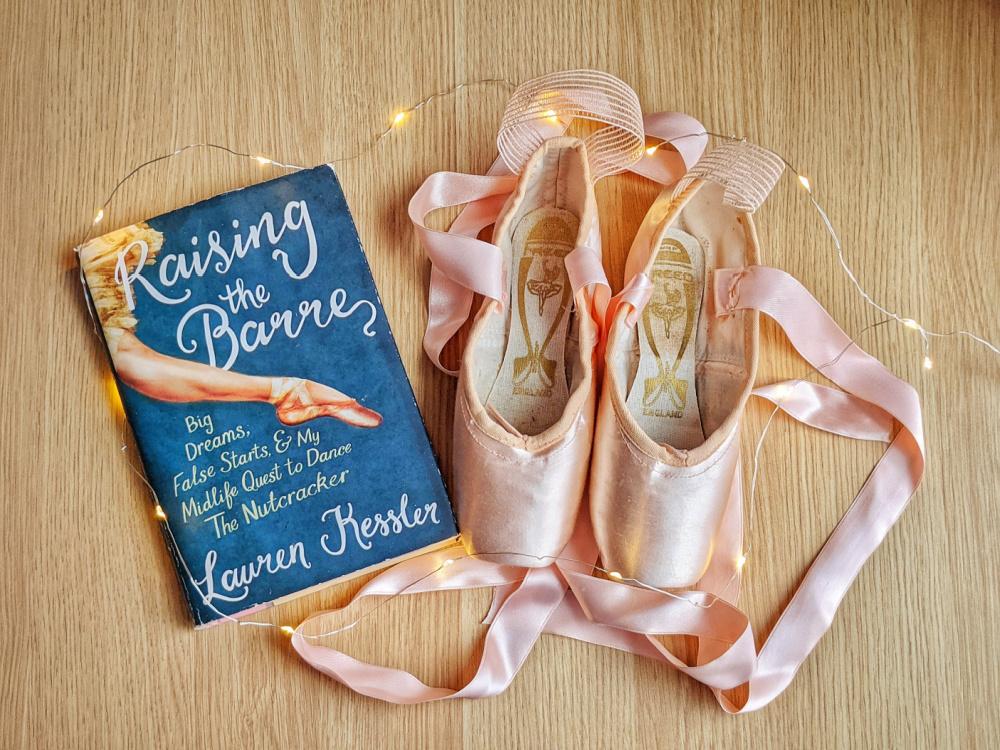Memoir Raising the Barre by Lauren Kessler, fairy lights, and pointe shoes.