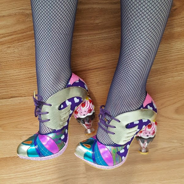 wearing heart print shoes with metallic details and ice cream sundae heels
