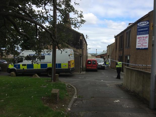 VIDEO: Police raid Chapel Green Works, in Centre Street, off Little Horton Lane, Little Horton
